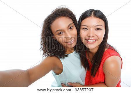 Positive girls making photos