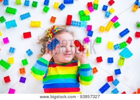 Little Girl Playing With Colorful Toy Blocks