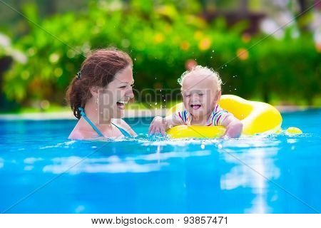 Mother And Baby In A Swimming Pool