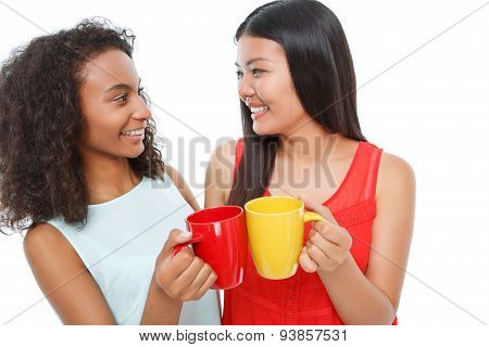 Positive friends drinking tea.