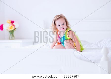 Little Girl Jumping On A Bed