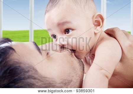 Father Showing His Love By Kissing His Baby