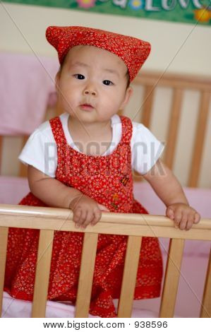 Cute Asian Baby With Inquisitive Expression