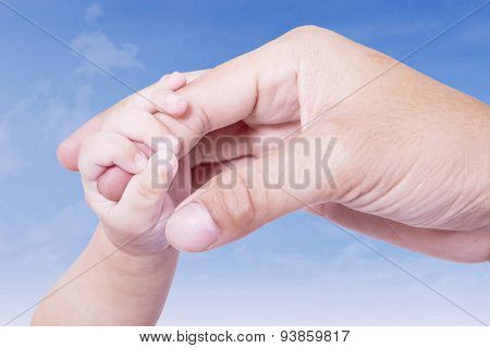 Infant Hand Gripping Father Finger