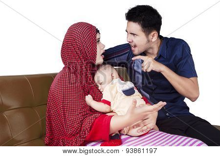 Two Parents Quarrel While Holding A Baby