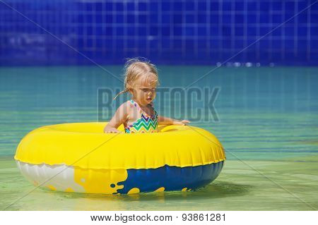 Funny Portrait Of Cheerful Baby Girl Swimming In Water Park