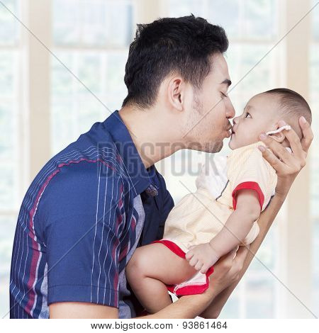 Young Dad Kiss His Male Infant