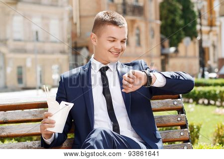 Young man checking time in park