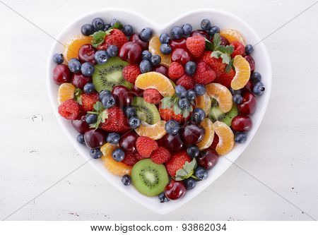 Colorful Rainbow Fruit In Heart Shape Bowl.