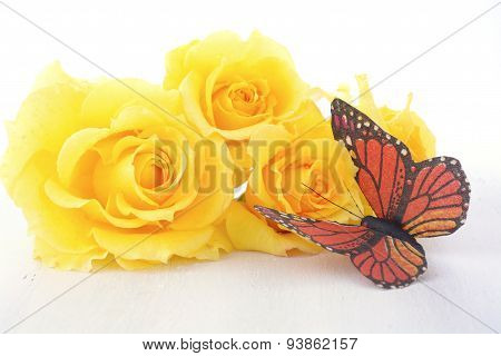 Beautiful Yellow Roses On Rustic Wood Table.