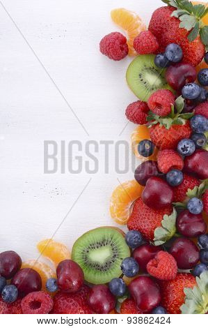 Fresh Organic Wholesome Fruit On White Wood Table.