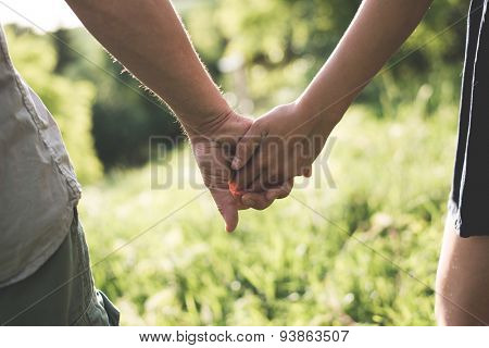 Holding hands, love concept