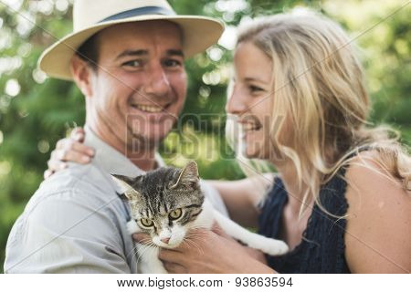 Happy couple with cute kitten