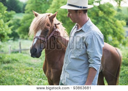 Horse and man in panama hat