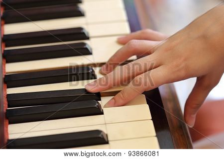 Hands Playing The Classic Wood  Piano