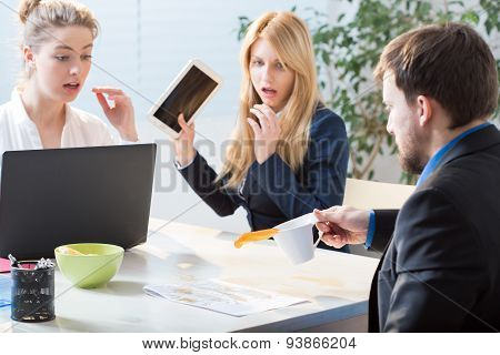 Man Spilling Tea On Documents