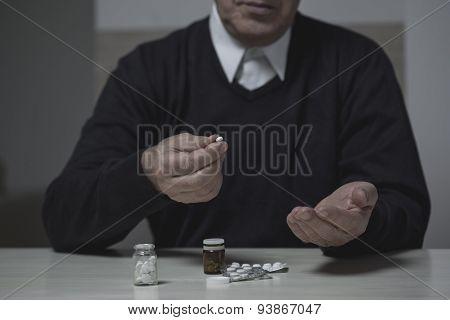 Pensioner Taking Pills