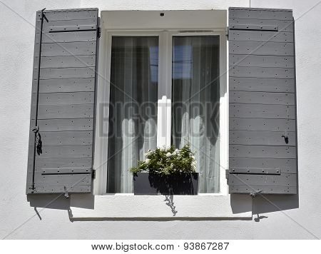 Gray house with white windows