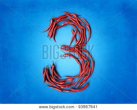 3D rendering of number three formed with chili peppers on a blue background