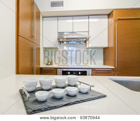 Modern, bright, clean, kitchen interior with stainless steel appliances.