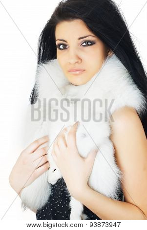 Attractive girl covered in white fur