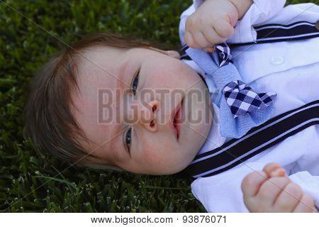 Baby Boy Lying In Grass