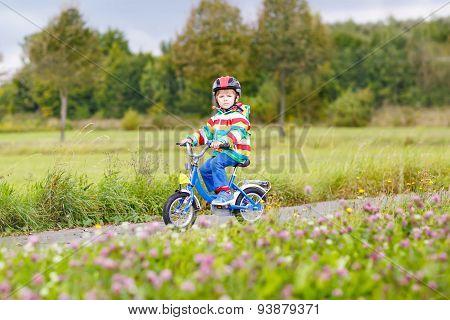 Cute Active Little Boy Riding On Bike