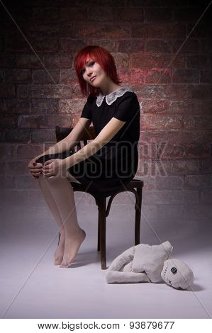 Red-haired Girl With Doll In A Gloomy Atmosphere