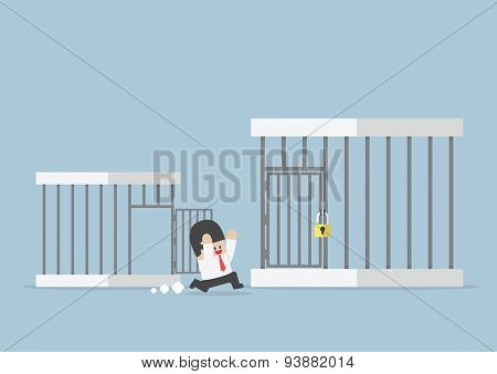 Businessman Runing Out From Small Cage To The Bigger Cage