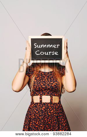 University College Student Holding A Chalkboard Saying Summer Course