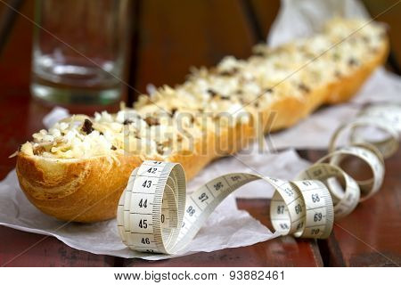 Baguette and measure tape diet concept