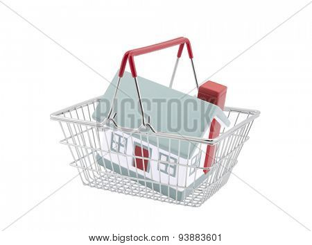Shopping basket with house miniature isolated on white background