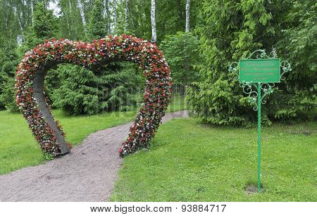 Big Heart (topiary Figure) Of Fresh Flowers In The Park. Log On To The Valley Of Love Through