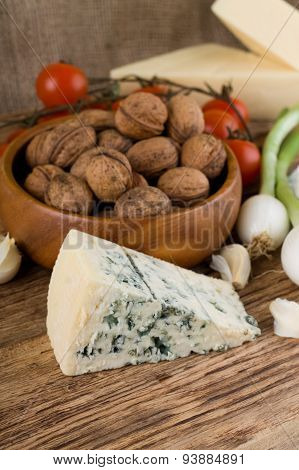 Big Portion Of Niva Cheese In Front Of Various Vegetable