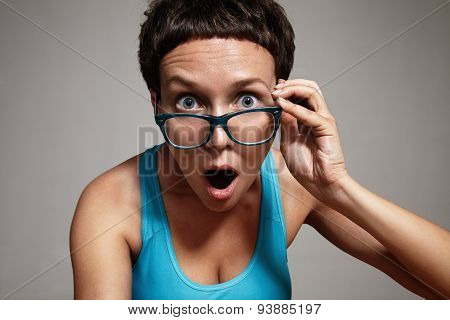 Wondering Woman Watching Oover Her Glasses