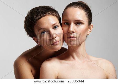 Two Pretty Girls Touching Cheek To Cheek. Healthy Skin