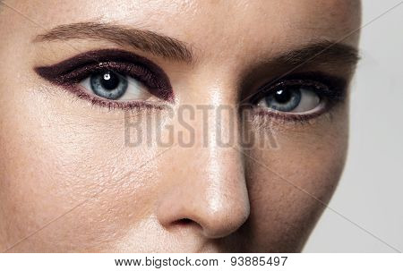 Closeup Of Women's Eyes With Bright Cat Eye Makeup