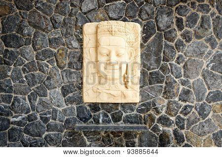 Face Of Sandstone Carving Hang On The Stone Wall