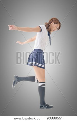 Japanese style school girl in sailor suit, full length portrait.