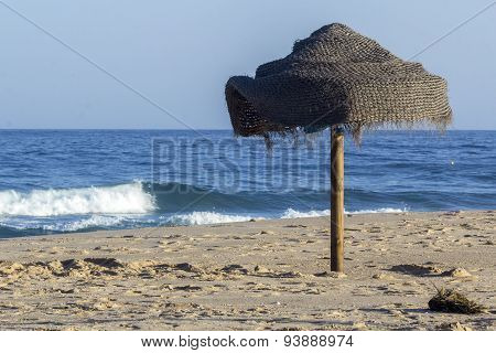 Parasol In Beach Sand And Atlantic Ocean View From Tavira Island, Algarve.