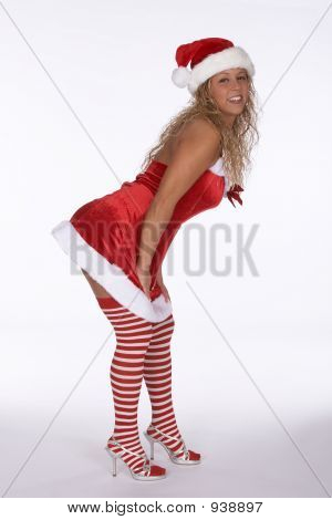 Female Santa In Red Dress With Stripped Stockings Bending Forward