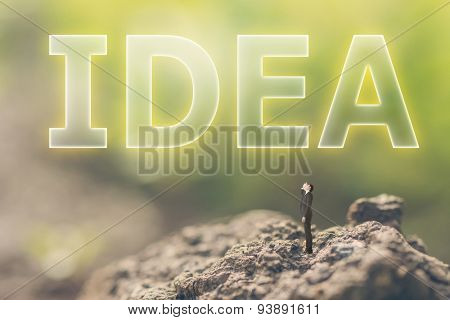 Concept of plan with a person stand in the outdoor and looking up the text over the sky in nature background.