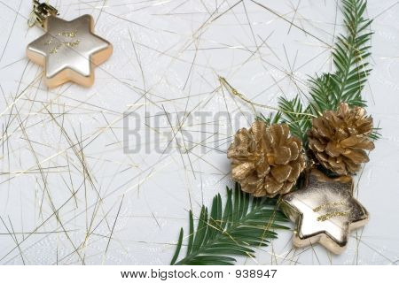 Holiday Card With Fir Branch, Star Ornaments And Golden Cones