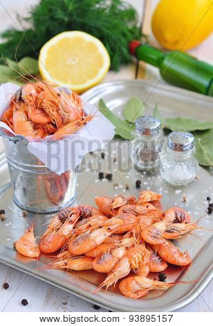 Fresh shrimps with salt and peppers on a bucket