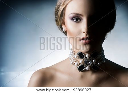 Portrait of beautiful girl in shiny jewels.