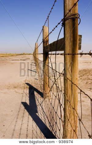 Wire And Wooden Fence Under Clear Skies