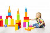 stock photo of brick block  - Baby Kid Play Block Toys Building Child Boy Constructor Playing Bricks Game Children Room over White background - JPG