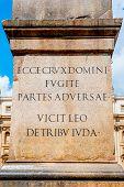 stock photo of obelisk  - Vatican obelisk base detail with latin inscription St Peter square in Rome Italy - JPG
