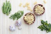 stock photo of pea  - Pasta in a clay pot - JPG