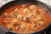 stock photo of meatball  - ragout of meatballs of beef stir fried in pan - JPG